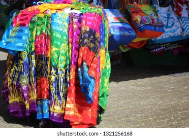 Beautiful colorful silk shawls for sale. Street market. Background.