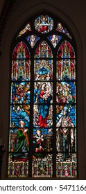 beautiful and colorful stained glass window with lots of details (Riga cathedral, Latvia, Europe)