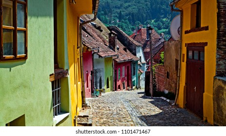 Beautiful colorful street in Sighisoara in typical traditional style. Sighisoara is the place Dracula is born.