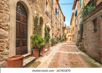 Beautiful and colorful streets of the small and historic Tuscan village Pienza, Italy