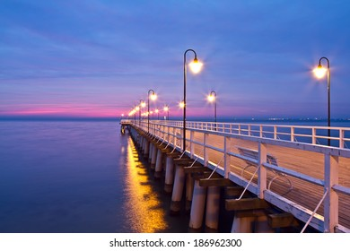 Beautiful colorful Sunrise on the pier at the seaside, Gdynia Orlowo, Poland. Long exposure photography. HDR photo