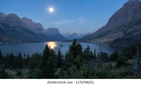 Beautiful colorful sunrise over St. Mary Lake and wild goose island in Glacier national park, Montana, USA