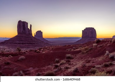 Beautiful colorful sunrise view of famous Buttes of Monument Valley on the border between Arizona and Utah, USA