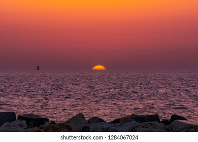 Beautiful and colorful Sunset horizon sea water landscape at Trapani in Sicily, Italy. Orange sunset sea horizon view at Trapani in Sicily, Italy. Colorful Sunset over sea with orange background.