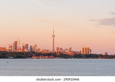Beautiful and colorful sunset over Lake Ontario in Toronto, Canada, with skyline