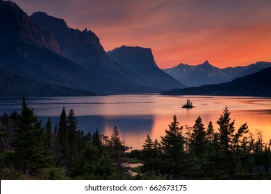 Beautiful colorful sunset over St. Mary Lake and wild goose island in Glacier national park, Montana, USA
