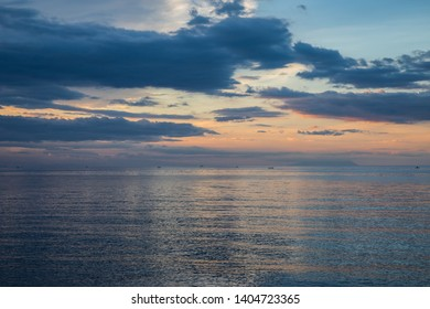 Beautiful and colorful sunset over very calm sea in Lovina, BALI