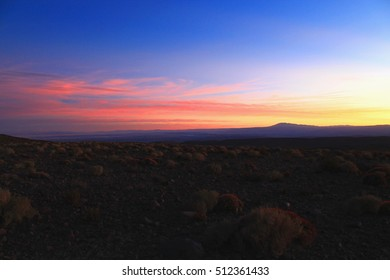 beautiful colorful sunset seen from the mountains of the andean at puritama over the oasis plateau of san pedro de atacama