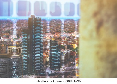 Beautiful colorful toned aeroview image of Milan, Italian urban cityscape with skyscrapers and different buildings on the streets and background with the sunset