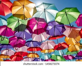 Beautiful colorful umbrellas against a deep blue sky.