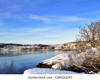 Beautiful and colorful winter landscape. The city of Larvik (Norway) covered with snow during a sunny day.