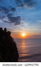 Beautiful colors of the sunset at Ulu Watu temple on Bali, Indonesia