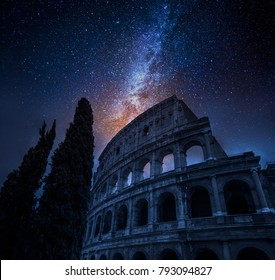Beautiful Colosseum in Rome at night and milky way, Italy