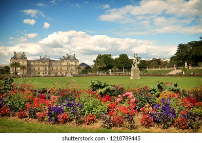 Beautiful colourful flowers in Jardin du Luxembourg with building in the background