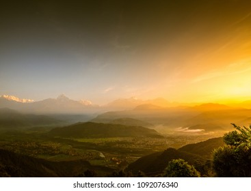 A beautiful and colourful panoramic shot of Annapurna Range during sunrise taken from Sarangkot, Pokhara, Nepal