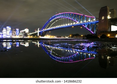 Beautiful of colourful of Sydney Vivid light show festival celebration reflection on the Sydney harbour bridge taking from North SYD looking toward to city CBD skyline 6/6 2019, Australia