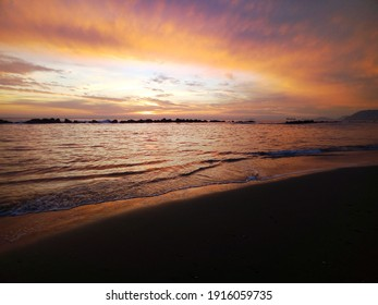 The beautiful colours of the sunset at the beach.