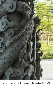 A beautiful column in the form of dragons in one of the temples of China. Pillar with dragon patterns