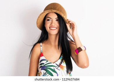 beautiful commercial model young woman brunette girl smiling posing in studio tropical summer fashion with hat