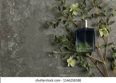 Beautiful composition with bottle of perfume on grey background, flat lay