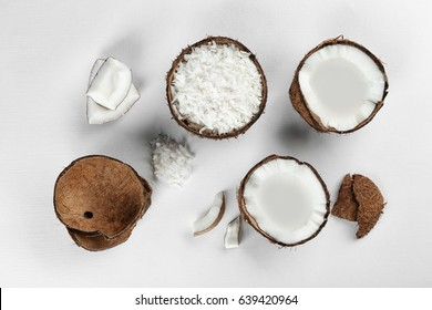 Beautiful composition with coconuts on white background