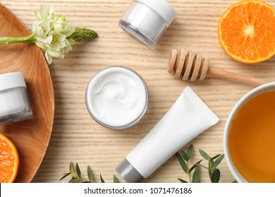 Beautiful composition with cosmetics on wooden background, flat lay