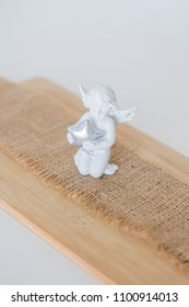 Beautiful composition, A figurine is an angel on wooden background