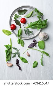 Beautiful composition with herbs on wooden background
