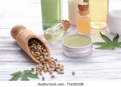 Beautiful composition with jar of hemp lotion on wooden background