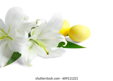 Beautiful composition with lilies and Easter eggs on white background