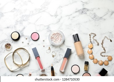 Beautiful composition with lipsticks and bijouterie on light background, flat lay