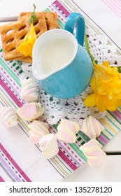 Beautiful composition of milk and cookies on wooden picnic table close-up