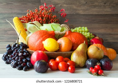 Beautiful composition of multicolored fresh vegetables on wooden table