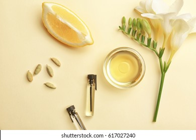Beautiful composition with perfume samples on color background