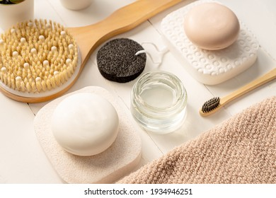Beautiful composition with spa cosmetics and personal accessories on wooden background.