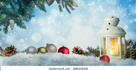Beautiful composition with vintage Christmas lantern and festive decorations on snow against color background, banner design. Bokeh effect