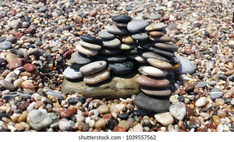 A beautiful concept with multicolored pebbles on the seashore.