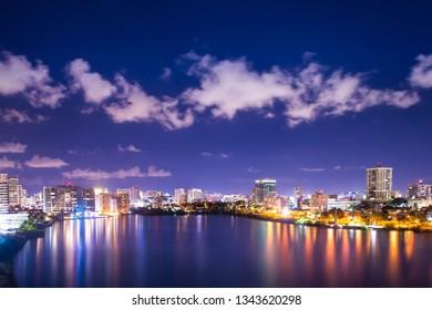 Beautiful Condado Beach, San Juan Puerto Rico seen at night with bay, buildings and lights