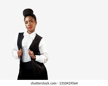 Beautiful confident African woman holding her stylish waistcoat looking forward