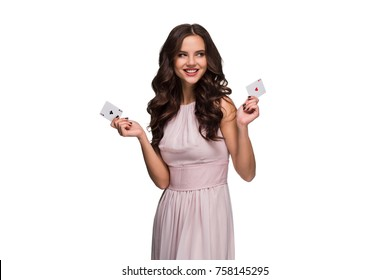 Beautiful confident woman showing poker cards looking at camera with copy place