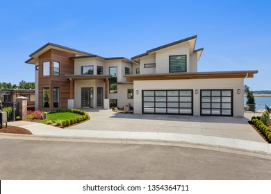 Beautiful Contemporary Home Exterior on Sunny Day. Has Three Car Garage
