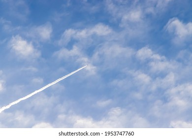 Beautiful contrail and white clouds in the blue sky