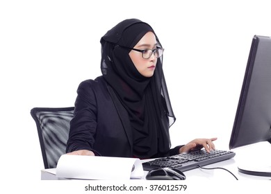 beautiful corporate muslimah woman with office attire working on desktop computer