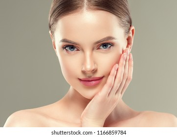 Beautiful cosmetic woman with healthy skin and hair natural makeup studio portrait