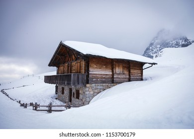 Beautiful Cottage in a winter landscape wonderland in Meran Italy isolated