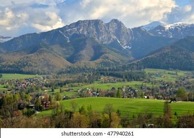 Beautiful country view with mountains in the background. View of the Tatra Mountains and Koscielisko Village in Poland.