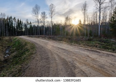 beautiful countryside gravel road in sunset. Latvia, spring