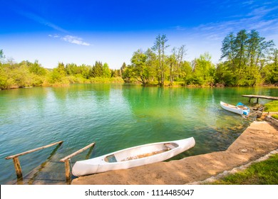 Beautiful countryside landscape and canoes in village of Belavici on Mreznica river in Croatia