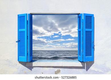Beautiful countryside through blue window