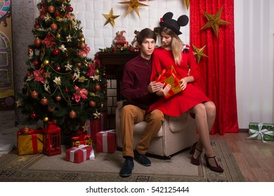 Beautiful couple at Christmas on the Christmas tree for New Year